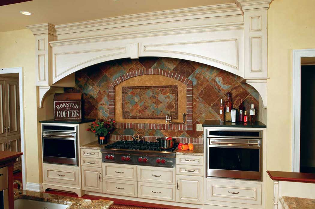 Combining Kitchen Cabinet Colors near the area of the Kitchen's cooking space complete with double ovens.