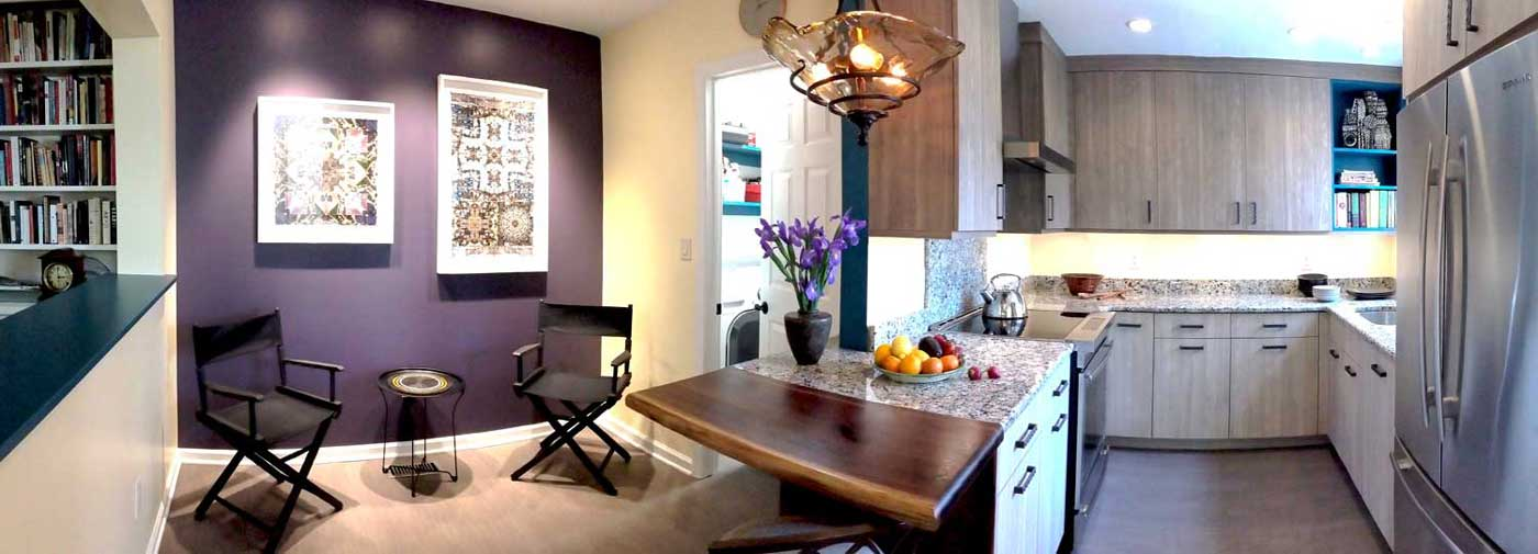 Cozy kitchen design with ceiling high cabinetry a small seating area with chairs and a table