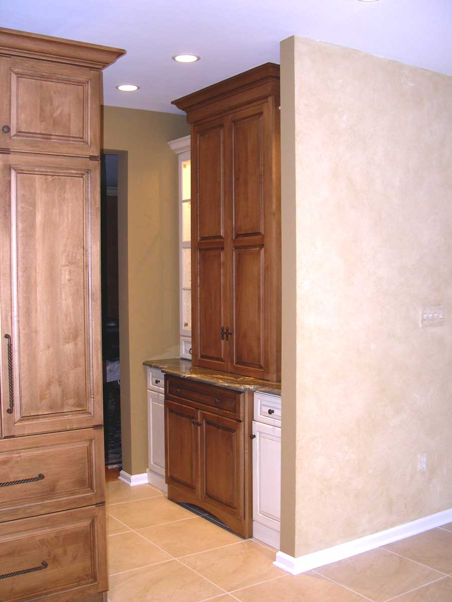 Traditional kitchen with stainless steel kitchen appliances and a drop zone for mail and school work