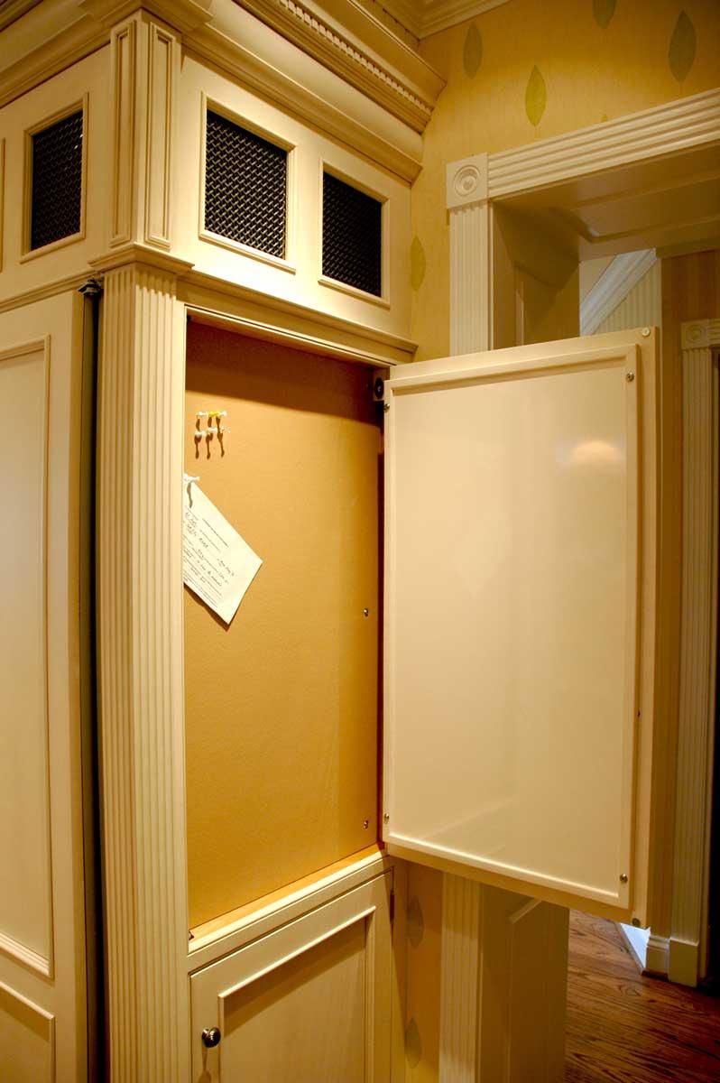 Custom built-in bulletin board in traditional kitchen design wall for optimal kitchen organization elements.