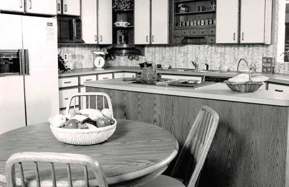Text: Black and White Vintage Picture of a Kitchen with White and Brown Cabinets in Wilmington Delaware