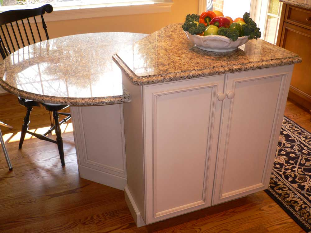 wicker fairfield kitchen cabinets for a multi level kitchen island with santa cecelia granite countertops