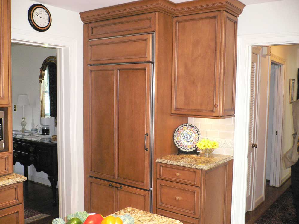 Maple Wood Panels conceal a large fridge to increase the style level of the kitchen design