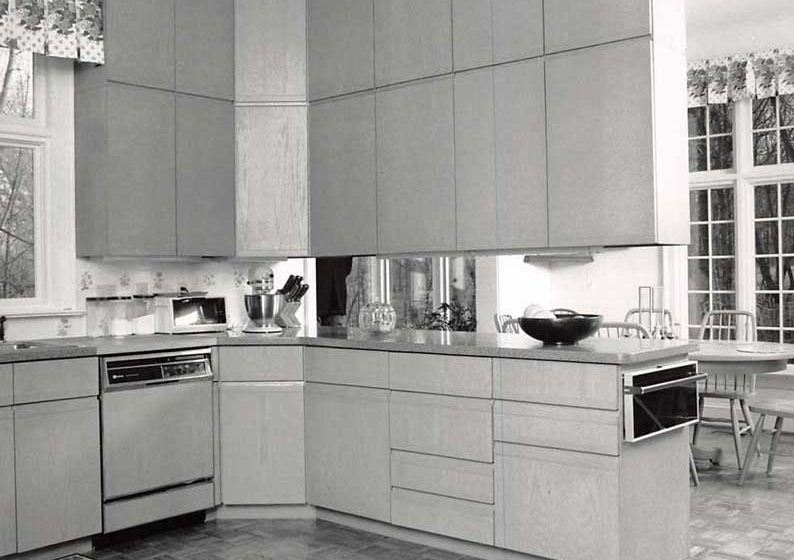 Vintage kitchen cabinets provide space for any needs, the design is elevated by a large window