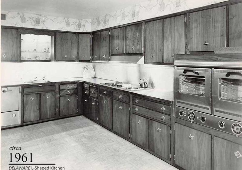 L-shaped vintage kitchen design from 1961 with extra prep space and double ovens for multi-family gatherings