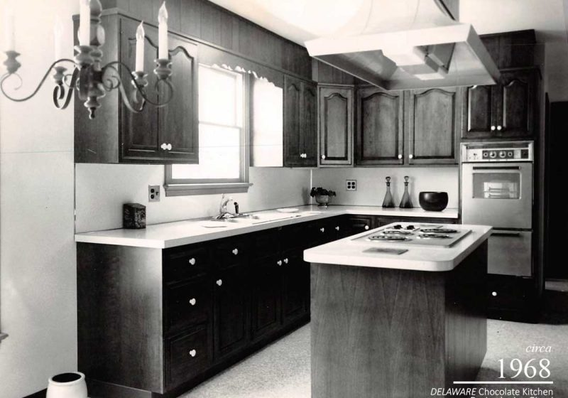Vintage kitchen from 1980 with functional elements that include a compact kitchen island and stove top