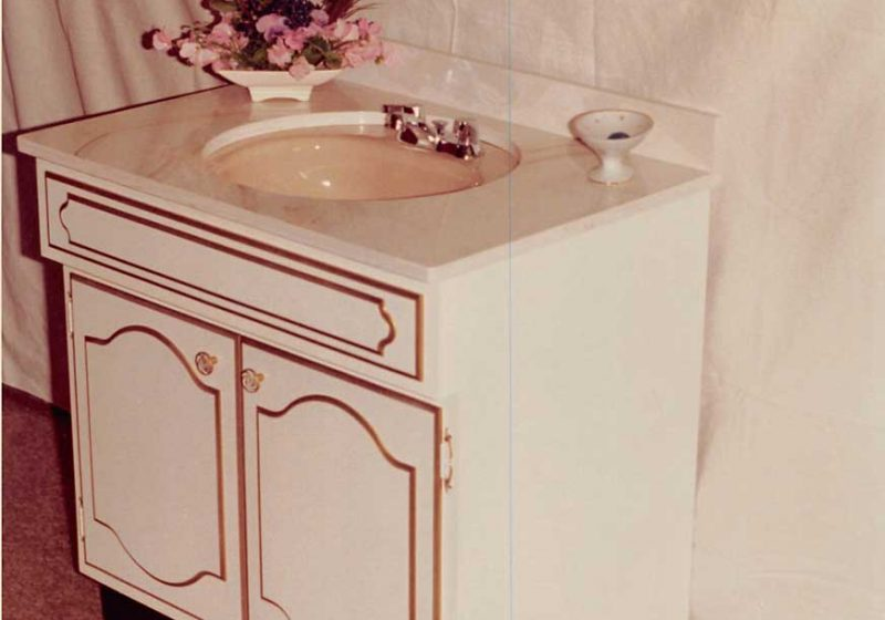 Elegant sink and cabinet design for a vintage kitchen from the 1990's, feminine design details throughout